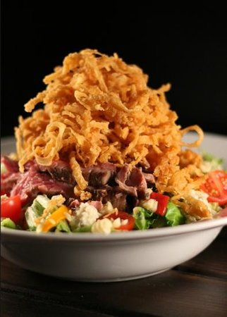 Corner Stable: steak salad with onion straws