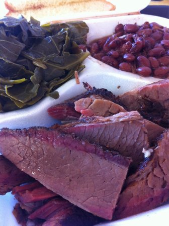 Coops Barbecue: Wood smoked beef brisket, tender collard greens, hearty red beans & rice