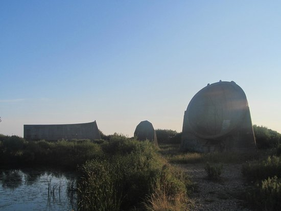 Romney Sands Holiday Park - Park Resorts: Dungeness Listening Ears seen from Nature reserve lake