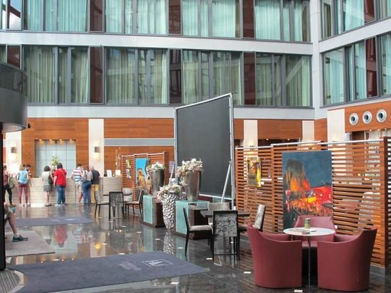 Eurostars Berlin Hotel: lobby/atrium check in desk, seating and large TV for World Cup