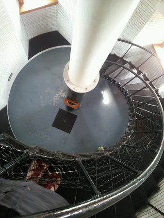 Split Rock Lighthouse: The iron lighthouse stairway, looking down. The white enamelled tower walls gleaming.