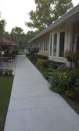 Palm Valley Fish Camp: Outdoor seating and side view of PV Fish Camp