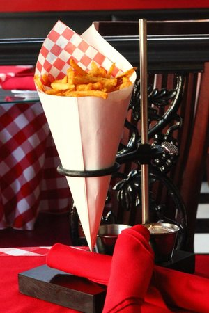 Le Bistro By Liz: Our Pomme Frites served with a light malt dust and garlic aioli
