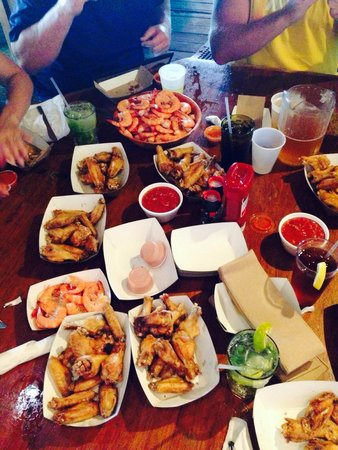 Sparky's Landing Fish and Cocktails: 200 Shrimp and 100 Wings!!  Happy Hour at Sparky's is the bomb!!