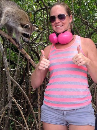 Air Boat USA: my wife with a wild raccoon