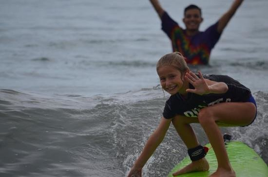 Blue Horizon Surf and Trips: Surfing while waving to her fans