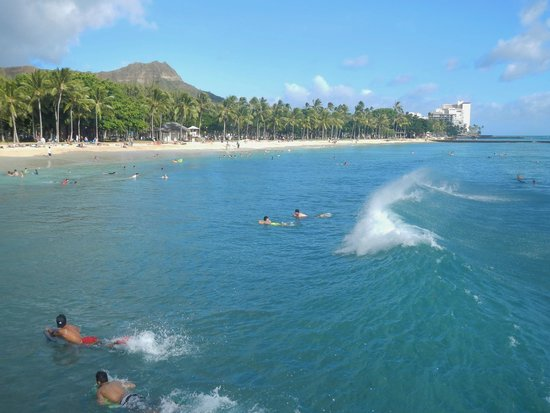 Waikiki Beach: Surfing on Waikiki with Diamond Head in the background