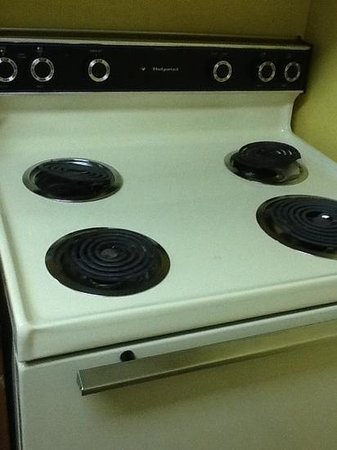 Residences at Daniel Webster: outdated electric stove, burners dont even seat in place