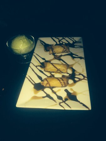 Kenny Tang's: Bananna dessert with white chocolate and Green tea ice cream on the side!! Yum!