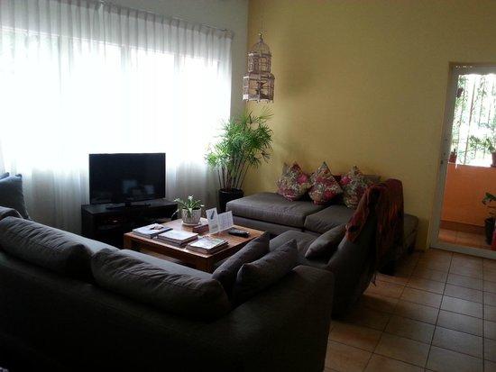 Orange Pekoe Guesthouse : Lounge area next to open office Orange Pekoe GH