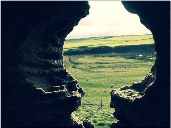 Dunstanburgh Castle: Through an arrow slit.