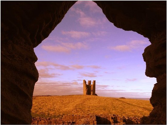 Dunstanburgh Castle: The far tower from the gatehouse window.