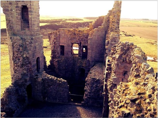 Dunstanburgh Castle: Looking downwards from the top of the gatehouse.