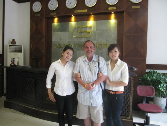 Golden Spring Hotel: With two of the wonderful hotel staff members