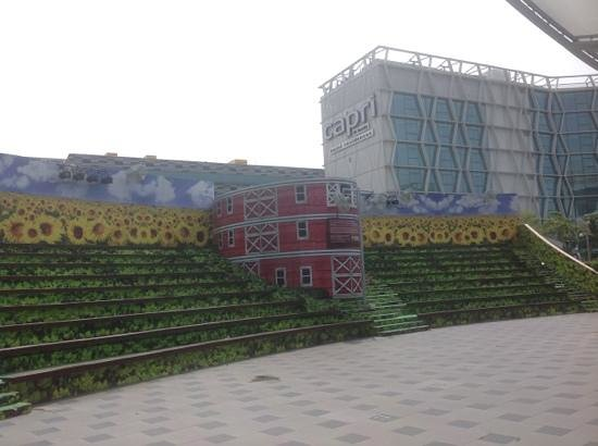 Capri by Fraser Changi City: view of hotel exterior from the little garden at changi city point