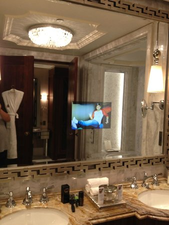 The St. Regis Abu Dhabi: Bathroom (with TV ON)