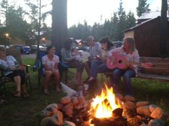 Gathering around the campfire at Historic Tamarack Lodge