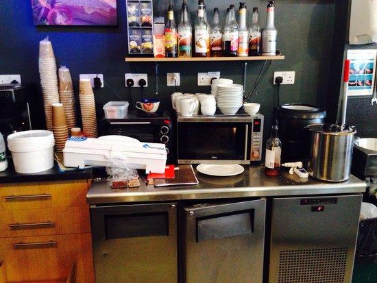 Cobbs Cafe: Open fridges, untidy work environment.