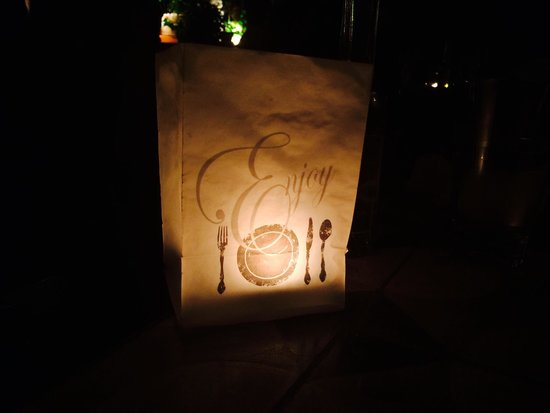 Aleria : The candles on the tables in the garden tables at the back... Enjoy