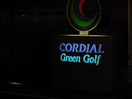 Cordial Green Golf: Complex sign lit up at night