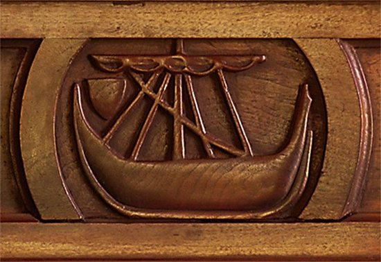 Oatfield Country House B&B: A carving of Somerled's Galley on the sitting room mantelpiece