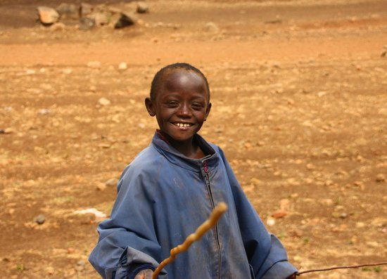 Olpopongi - Maasai Cultural Village & Museum: On the way to the village this boy greeted us