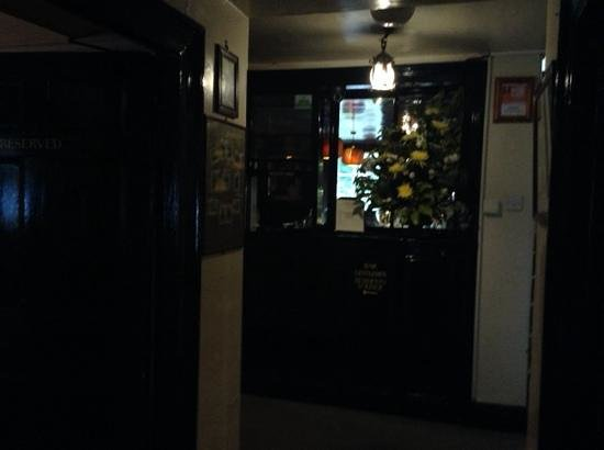 The Pheasant Inn: Hall leading to bar.