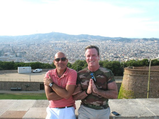 Rainbow Barcelona Tours: Peter & Dennis at Montjuic Castle with City of Barcelona Views in background.