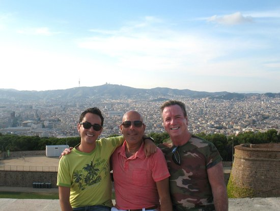 Rainbow Barcelona Tours: Eloi, Dennis,& Peter at Montjuic Castle with City of Barcelona views in background
