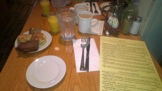 Irregardless Cafe: Menu with breads, coffee and OJ