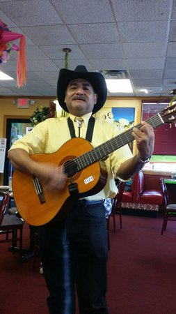 Mi Casa Mexican Restaurant : A Mexican gentleman singing to all the tables. It was very good and a nice surprise to this rest