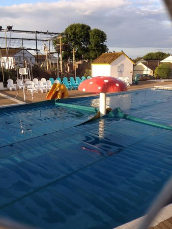 Golden Coast Holiday Village: Outdoor pool, clean and covered at night
