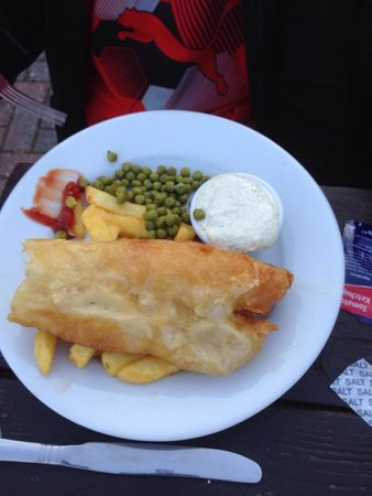 Golden Coast Holiday Village: Fish and chips at the old mill- fish had already been halved and chips hiden underneath (massive