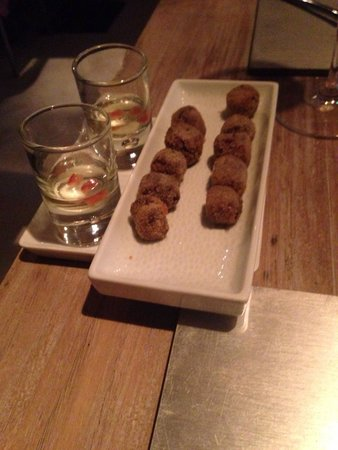 Con Gracia: Tomato consumé and black pudding croquettes