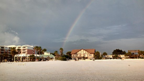 Palm Crest Resort Motel: Rainbow over Palm Crest from water edge
