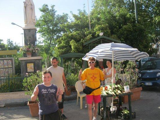 Hotel Joyfull: Mary and Italian family selling corn just down the street