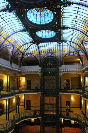 Gran Hotel Ciudad de Mexico: A view of the interior, the wrought iron elevator and the Tiffany glass ceiling