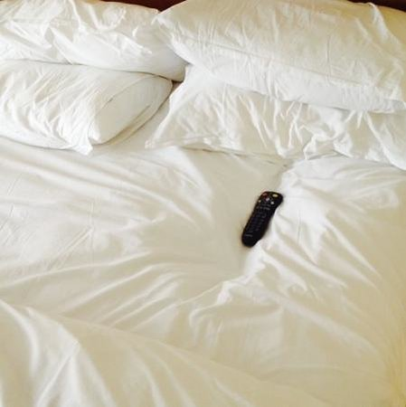 Sheraton Memphis Downtown Hotel: tv remote placed into sunk- in mattress!