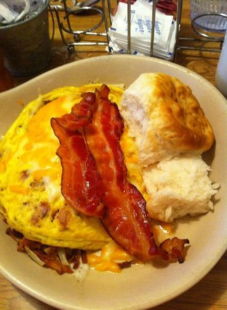 McFarlain's Family Restaurant: This is the breakfast Skillet, with hash browns, gravy, sausage, ham and cheese!  YUMMIES!!!!!