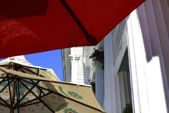 House of 1833: Looking at the sky from under the breakfast umbrellas