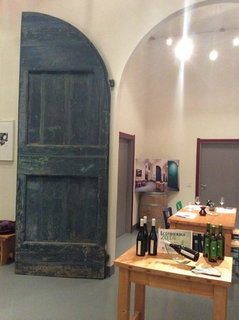 Discovering Umbria - Wine & Food Day Tours : 1700 year old door leading into the wine and olive oil tasting room