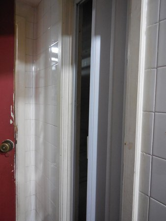 "Vila Carioca Hostel: ""door"" to unknown area of the hostel from inside the  4-person room with outdoor entrance"