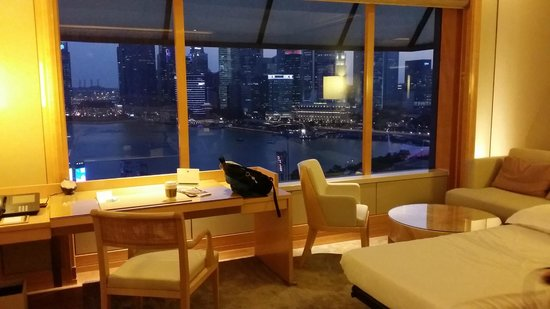 The Ritz-Carlton, Millenia Singapore: room showing rollaway bed and desk