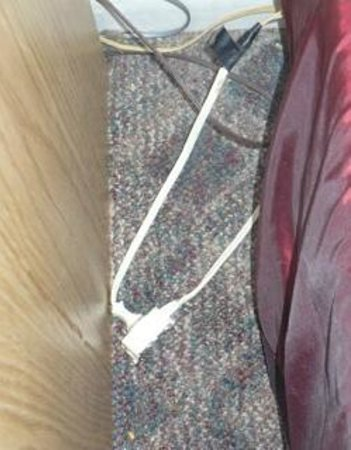 Golden Hills Motel: extension cord with electrical tape and popcorn kernel on floor