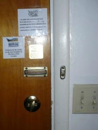 Golden Hills Motel: door with safety chain/bar lock removed/missing