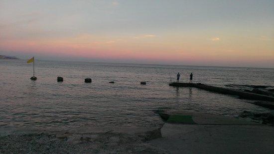 Le Saint Jean Plage: vue du restaurant au soleil couchant