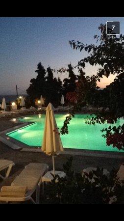 Eleni Apartments: Pool at dusk
