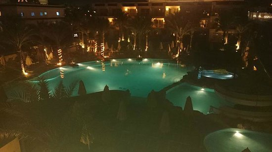 Xperience Sea Breeze Resort: Aqua Pool At night
