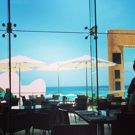 Beach Palace: View from breakfast, absolutely beautiful water. You can't get a view like this back in Florida