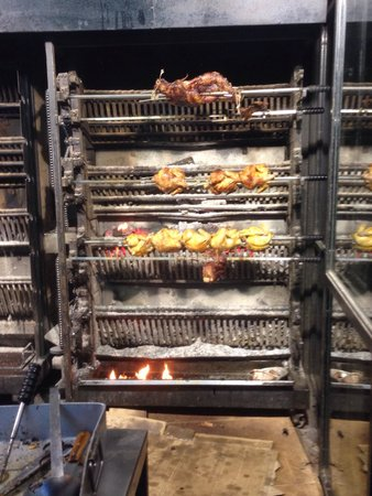 Pizzeria El Fornet : Wood fired rotisserie. A chickens best friend . So fresh.